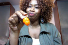 Woman Bites Into Hot Pepper With Hilarious Reaction