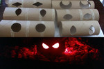 Use toilet rolls, cut out eye shaped holes, then put glowsticks inside and you have a creepy set of eyes ready to be placed in the dark.