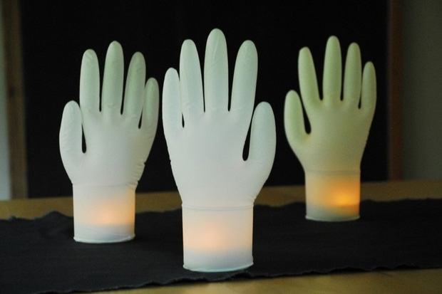 Inflate disposable gloves, fit a fake tealight candle inside and you've got glowing hands.