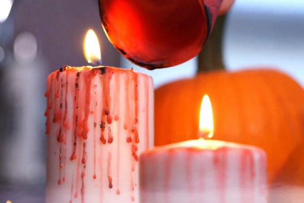 Drip red coloured wax onto a white candle for a bloody looking decoration.