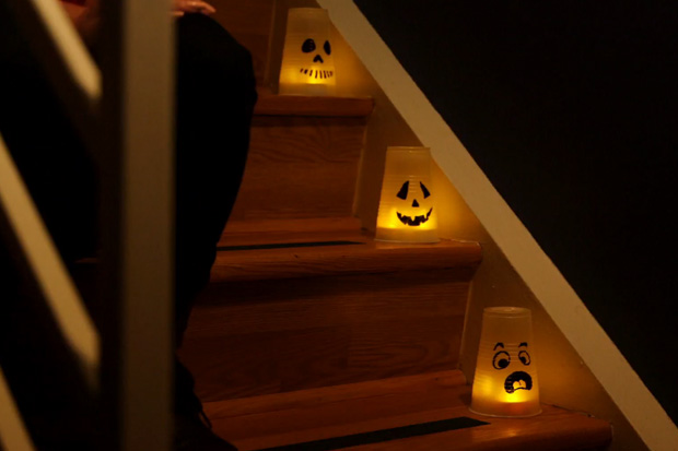 With markers, plastic cups and fake tealight candles, you can create creepy light up stairwells.