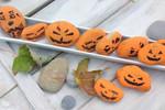 Paint rocks orange to create mini jack-o-lantern stones.