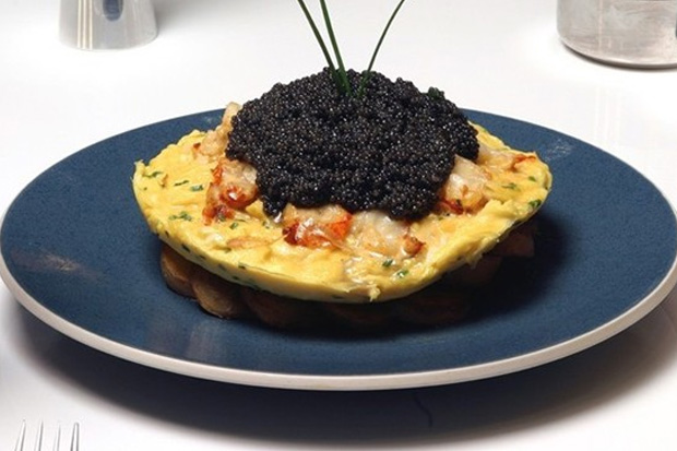 The Most Expensive Omelette: Zillion dollar lobster frittata from Norma's Restaurant in New York. 1 pound of lobser covered in egg on a bed of fried potatoes and topped with 280g of caviar. $1,000