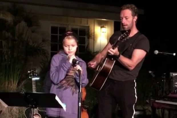 Chris Martin from Coldplay sings with his equally talented daughter