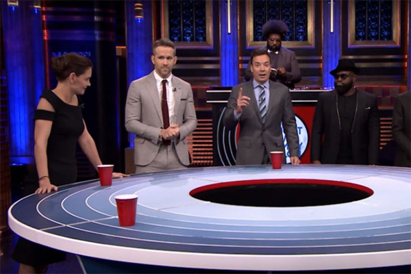 Katie Holmes shows her competive side against Ryan Reynolds and Jimmy Fallon