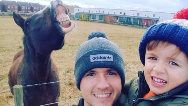 Owner demands half of father and son's winning from taking a selfie with her horse