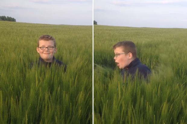 Boy in the middle of a field gets a surprise jump attack