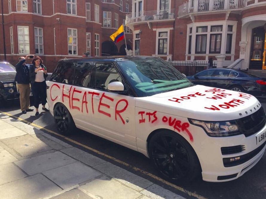 Woman graffitis over husband's Range Rover