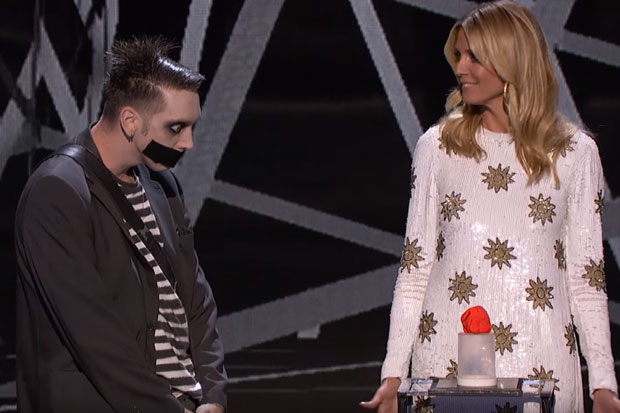 Tape Face tricks Heidi Klum into cuddling up with him