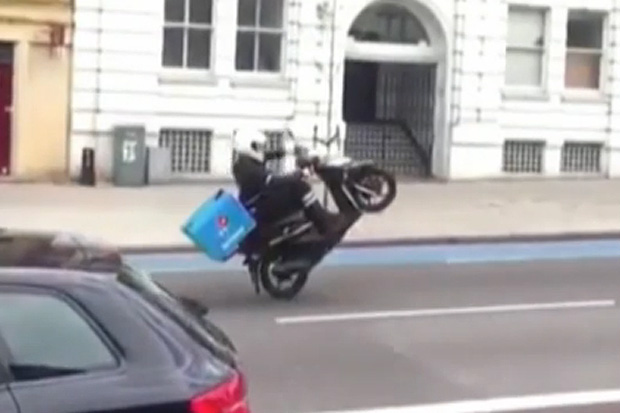 Show-off pizza delivery guy gets in trouble after falling off bike