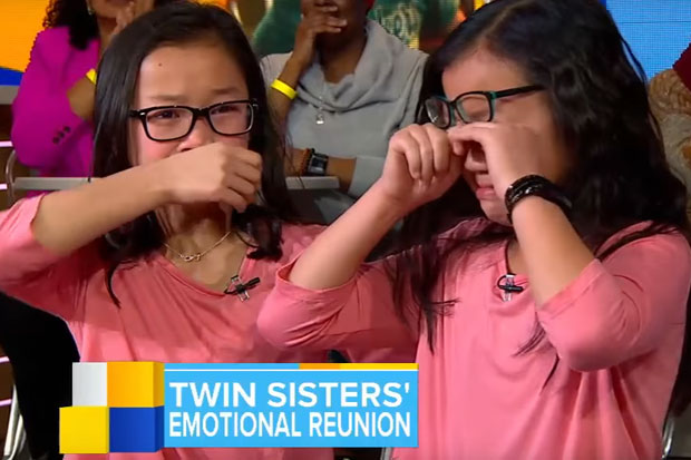 Identical twin sisters meet for the first time after being adopted by different families