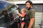 How To Dad teaches us how to wash a car using a baby