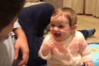 This wee girl can't stop laughing at her Dad's hilarious jokes