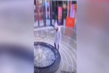 Woman faceplants into fountain because she's too busy being on her phone