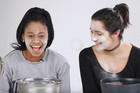 Women dunk their face in ice water for flawless makeup hack