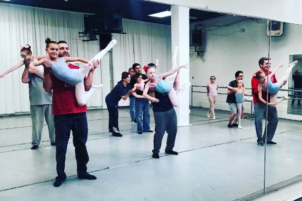Dads join daughters in special father-daughter ballet class