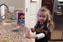 Adorable girl gets confused by her Mum's instructions while baking