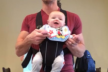 This Dad helps his baby do the 'Moonwalk' and it will brighten your day